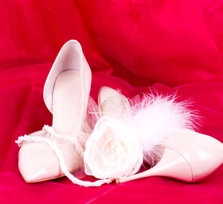 The beautiful bridal rose with wedding shoes photo