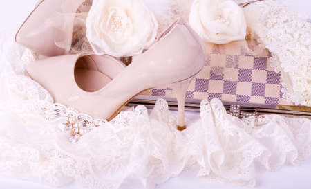 The beautiful bridal shoes, lace, bag and beads Stock Photo - 13156503