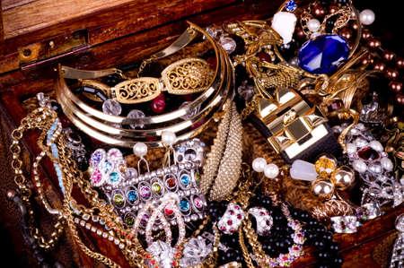 Golden jewelry background 스톡 콘텐츠