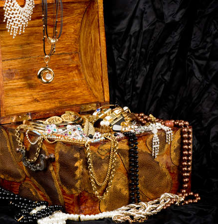 jewlery: Vintage wooden treasure trunk with jewelry on black background