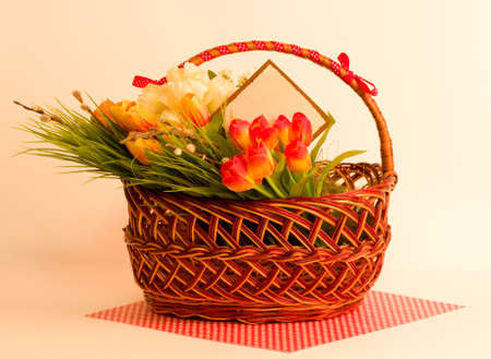 Easter spring flowers in basket with banner add Stock Photo - 13015376