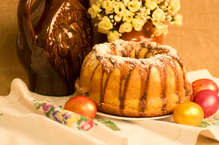 Traditional Easter cake and easter eggs with flowers photo