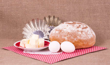 Baking cake, margarine and eggs on background photo