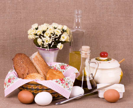 Baking cake, oil and eggs on background with flowers photo