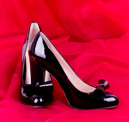 Sexy fashionable shoes on red background  Stock Photo - 13081790