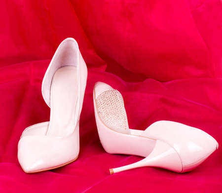Sexy fashionable shoes on red background Stock Photo - 13081782