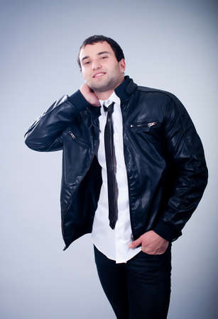 Fashionable man in jacket on gray background Stock Photo - 13156618