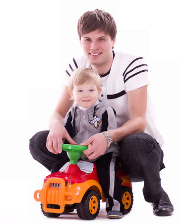 Joyful father and his baby son with small car photo
