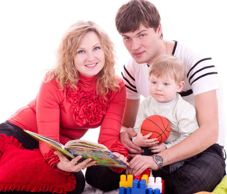 Family and baby boy with book  photo