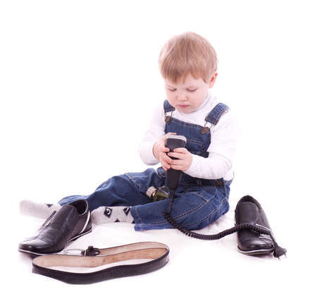 Toddler boy trying on her father s accessories and shoes Stock Photo - 13156561