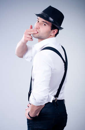Valentines romantic man in hat and suspenders photo