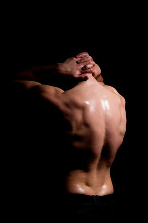 muscular man: Fashionable muscular man in a fashion pose