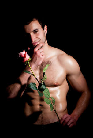 love hot body: Valentines man in a fashion pose with rose