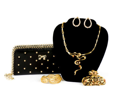 Fashionable handbag and golden jewelry on white background  스톡 콘텐츠