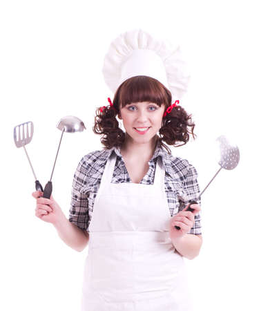 woman holds a cooking spoon and kitchen utensil photo