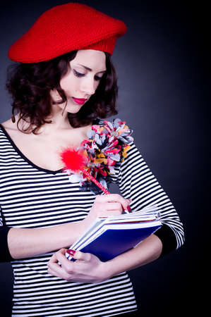 frenchwoman: Frenchwoman student in red beret with notebooks Stock Photo