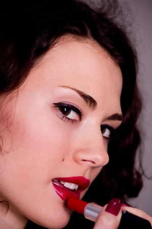 Beautiful girl with red gloss lips photo