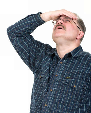 Portrait of old man having a headache on white background photo