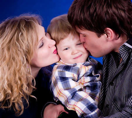 Beautiful young family with baby boy and flower Stock Photo - 13259218