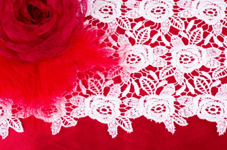 Vintage lace with flower on red background photo