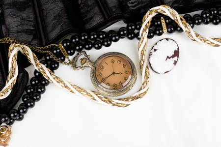 cameo: Black lace with form flower, clock and antique cameo