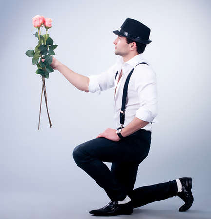 propose: Valentines Man with pink rose on background