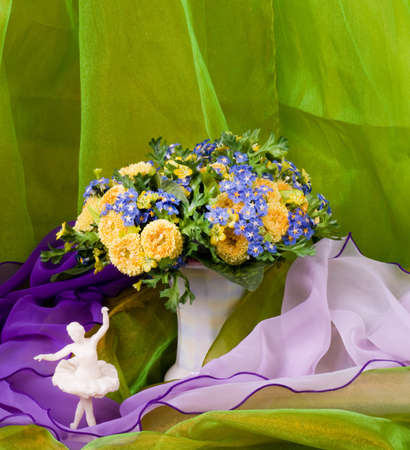 spring flowers in a glass vase and ballet-dancer photo