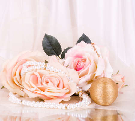 Vintage beads with roses and candle photo