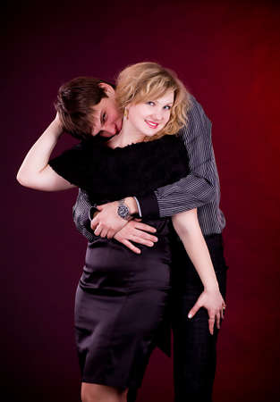 Couple of lover man and woman on dark background  photo