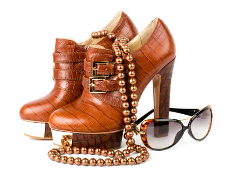 Sexy fashionable shoes and glasses isolated photo