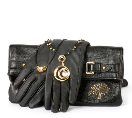 Fashionable handbag, gloves and golden jewelry photo