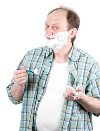 beautycare: Senior man with a shaving foam