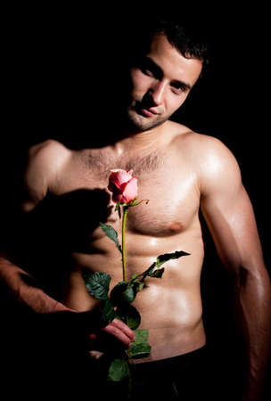 Valentines man in a fashion pose with rose photo
