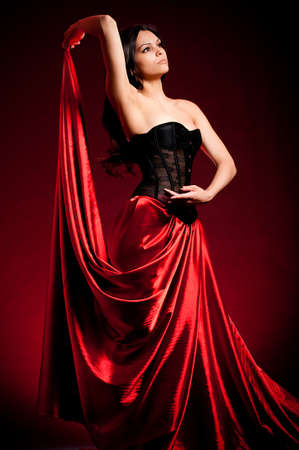 Flamenco Carmen beautiful woman in dress on dark background photo