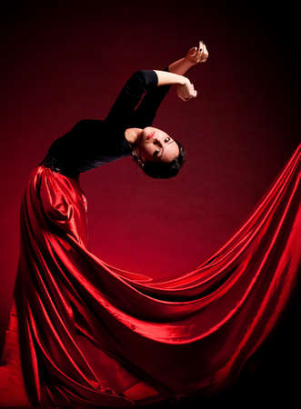 Flamenco Carmen beautiful woman in dress on dark background