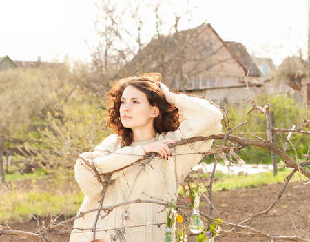 Beautiful woman in stocking sweater on spring nature photo