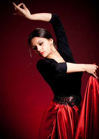 Flamenco Carmen beautiful woman in dress on dark background
