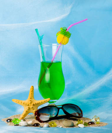 fruit drinks: Exotic cocktail with tropical starfish and glasses