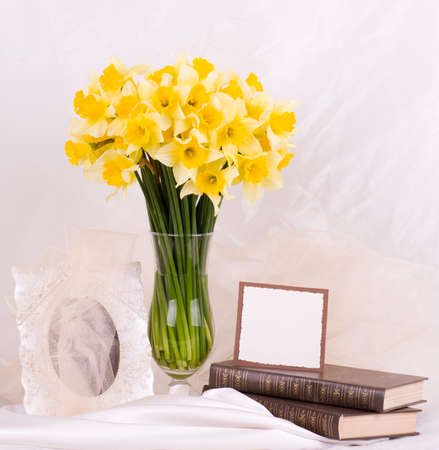 Beautiful spring flowers in a glass vase with banner add photo