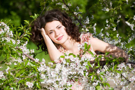 Beautiful woman in spring flowers Stock Photo - 13593974