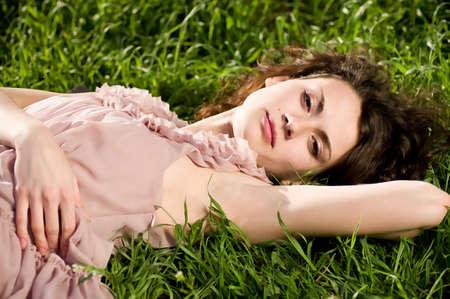 Beautiful woman in spring green grass photo