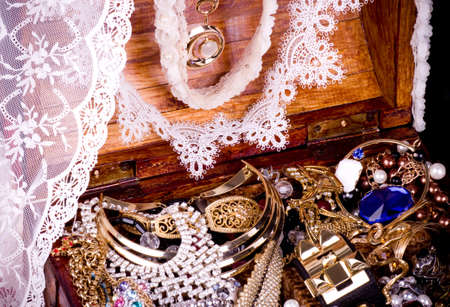 Golden jewelry background with lace photo
