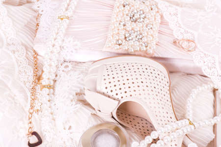 The beautiful bridal shoes, bag and beads photo