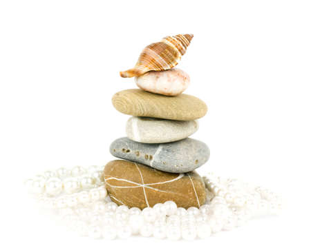 Beautiful exotic shell and stones, pearls on white background  photo