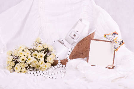 The beautiful bridal shoes, lace and wedding rings with banner add photo