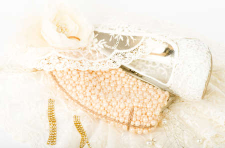 The beautiful bridal shoes, lace, bag and beads photo