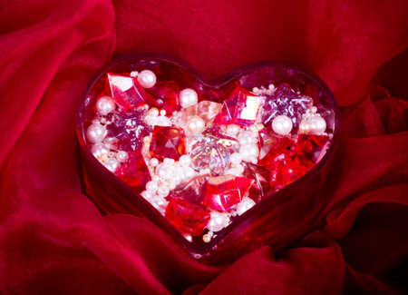 Beautiful bright colorful stones and pearl in heart for valentine day photo