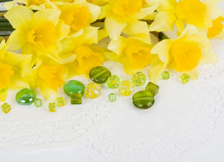 Beautiful spring yellow flowers and colorful stones photo