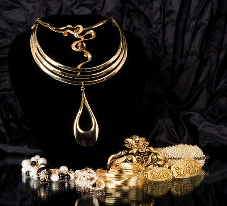diamond necklace: Golden jewelry on black background