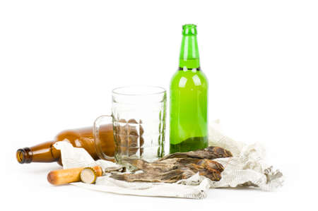 Hand with beer brown bottle isolated on a white photo